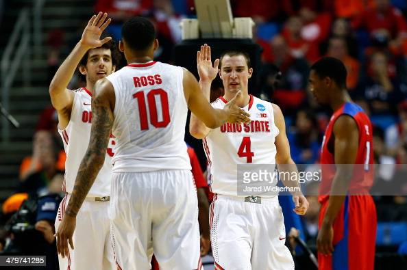 LaQuinton Ross celebrates with Amedeo Della Valle and Aaron Craft of the Ohio State Buckeyes against the Dayton Flyers during the second round of the...