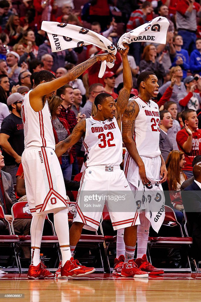 LaQuinton Ross #10, Lenzelle Smith, Jr. #32, and Amir Williams #23 celebrate after Sam Thompson #12, all of the Ohio State Buckeyes, dunked the ball against the North Dakota State Bison during the second half at Value City Arena on December 14, 2013 in Columbus, Ohio. Ohio State defeated North Dakota State 79-62.