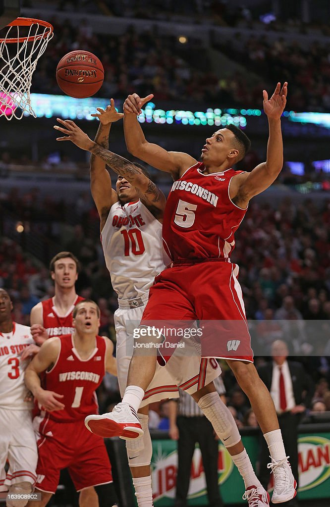 LaQuinton Ross #10 of the Ohio State Buckeyes and Ryan Evans #5 of the Wisconsin Badgers battle for a rebound during the Big Ten Basketball Tournament Championship game at United Center on March 17, 2013 in Chicago, Illinois. Ohio State defeated Wisconsin 50-43.