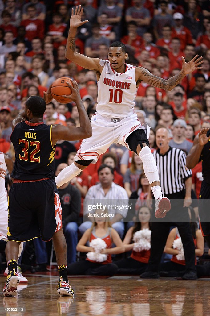 LaQuinton Ross #10 of the Ohio State Buckeyes applies defensive pressure to <a gi-track='captionPersonalityLinkClicked' href=/galleries/search?phrase=Dez+Wells&family=editorial&specificpeople=9960403 ng-click='$event.stopPropagation()'>Dez Wells</a> #32 of the Maryland Terrapins in the second half on December 4, 2013 at Value City Arena in Columbus, Ohio. Ohio State defeated Maryland 76-60.