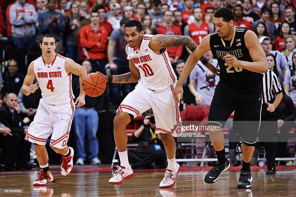 LaQuinton Ross of the Ohio State Buckeyes brings the ball up court after a turnover in the second half as AJ Hammons of the Purdue Boilermakers and...