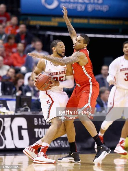 LaQuinton Ross of the Ohio State Buckeyes defends Walter Pitchford of the Nebraska Cornhuskers during the Quarterfinals of the Big Ten Basketball...