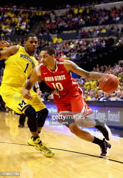 LaQuinton Ross of the Ohio State Buckeyes drives the ball past Glenn Robinson III of the Michigan Wolverines during the second half of the Big Ten...