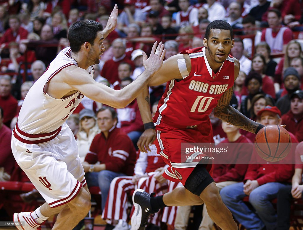 LaQuinton Ross of the Ohio State Buckeyes drives to the basket against Will Sheehey of the Indiana Hoosiers at Assembly Hall on March 2 2014 in...