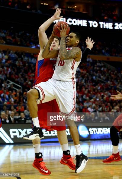 LaQuinton Ross of the Ohio State Buckeyes goes to the basket as Matt Kavanaugh of the Dayton Flyers defends during the second round of the 2014 NCAA...