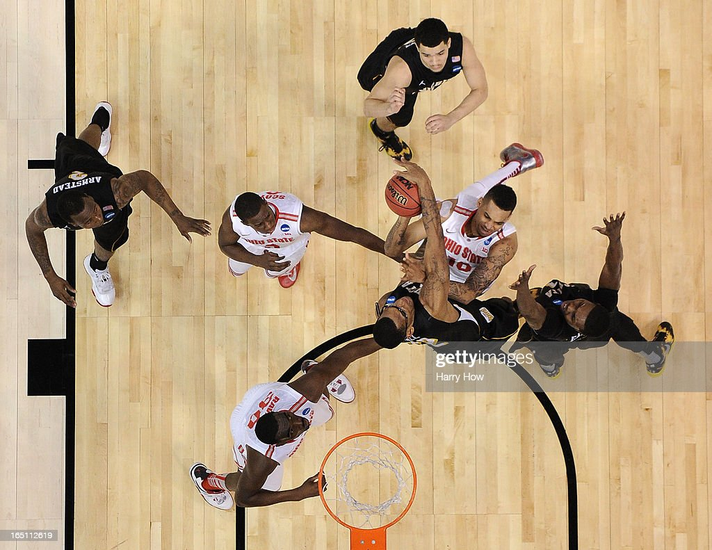 LaQuinton Ross of the Ohio State Buckeyes goes up for a shot against Carl Hall and Cleanthony Early of the Wichita State Shockers in the first half...