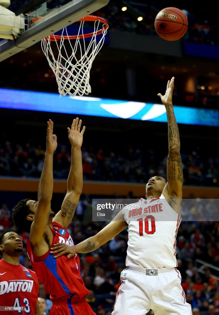 LaQuinton Ross of the Ohio State Buckeyes goes up for a shot against Devin Oliver of the Dayton Flyers during the second round of the 2014 NCAA Men's...