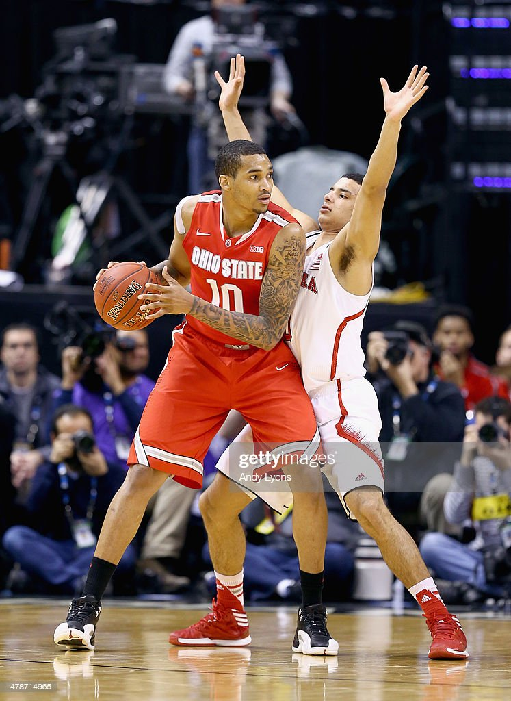 LaQuinton Ross of the Ohio State Buckeyes looks to pass the ball while defended by Tai Webster the Nebraska Cornhuskers during the Quarterfinals of...