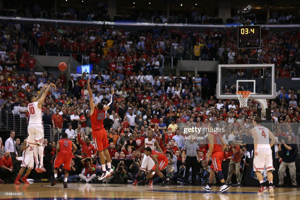 LaQuinton Ross #10 of the Ohio State Buckeyes makes a three-pointer over <a gi-track='captionPersonalityLinkClicked' href=/galleries/search?phrase=Grant+Jerrett&family=editorial&specificpeople=7887154 ng-click='$event.stopPropagation()'>Grant Jerrett</a> #33 of the Arizona Wildcats in the final seconds during the West Regional of the 2013 NCAA Men's Basketball Tournament at Staples Center on March 28, 2013 in Los Angeles, California.