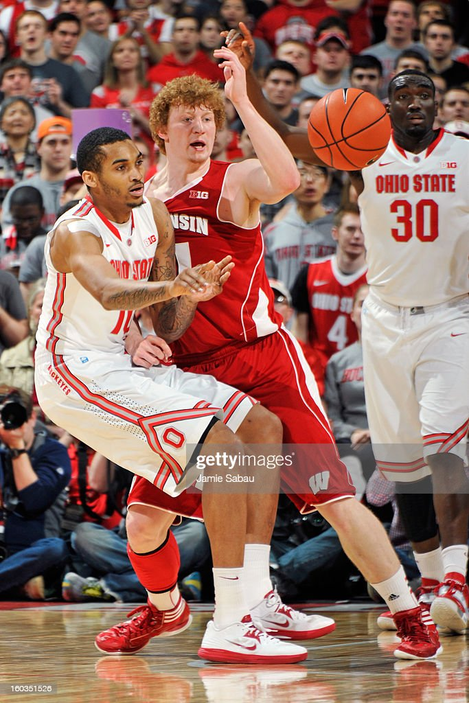 LaQuinton Ross #10 of the Ohio State Buckeyes passes off the ball as Mike Bruesewitz #31 of the Wisconsin Badgers defends in the first half on January 29, 2013 at Value City Arena in Columbus, Ohio. Ohio State defeated Wisconsin 58-49.