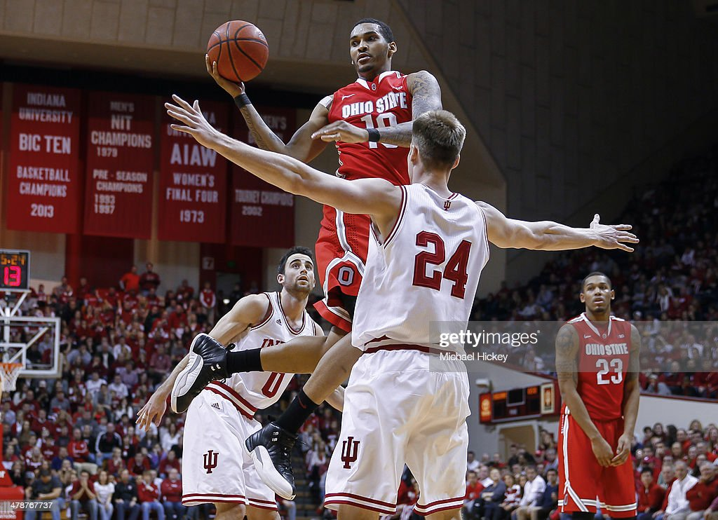 LaQuinton Ross of the Ohio State Buckeyes passes off the basll during the game against the Indiana Hoosiers at Assembly Hall on March 2 2014 in...