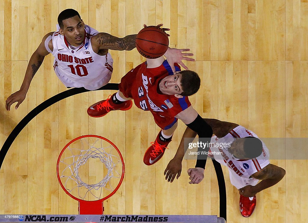 LaQuinton Ross of the Ohio State Buckeyes reaches for a rebound in the final seconds of the second half in front of Matt Kavanaugh of the Dayton...