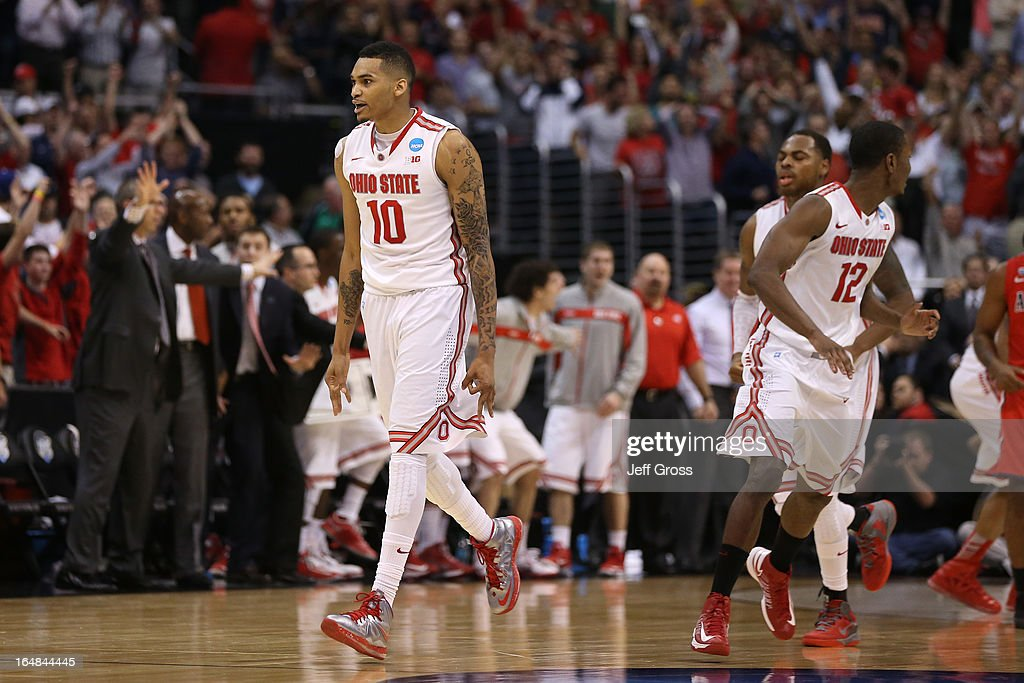 LaQuinton Ross of the Ohio State Buckeyes reacts after he hits a threepointer in the final second against the Arizona Wildcats during the West...