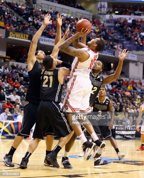 LaQuinton Ross of the Ohio State Buckeyes shoots the ball in the game against the Purdue Boilermakes during the first round of the Big Ten Basketball...