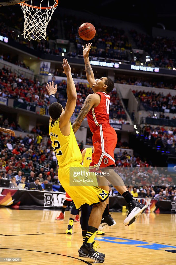LaQuinton Ross of the Ohio State Buckeyes takes a shot above Jordan Morgan of the Michigan Wolverines during the second half of the Big Ten...