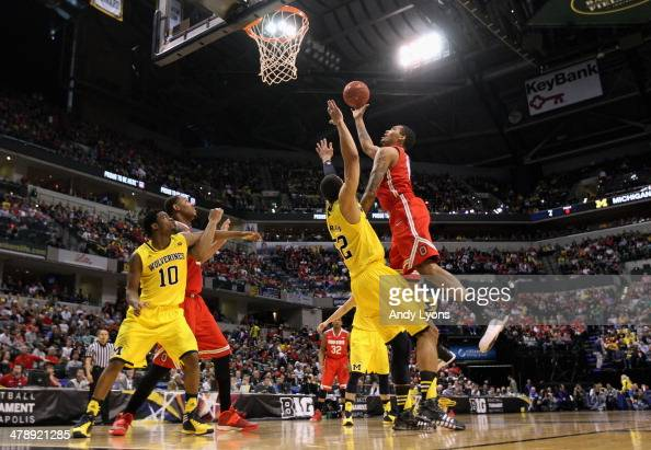 LaQuinton Ross of the Ohio State Buckeyes takes a shot over Jordan Morgan of the Michigan Wolverines during the second half of the Big Ten Basketball...