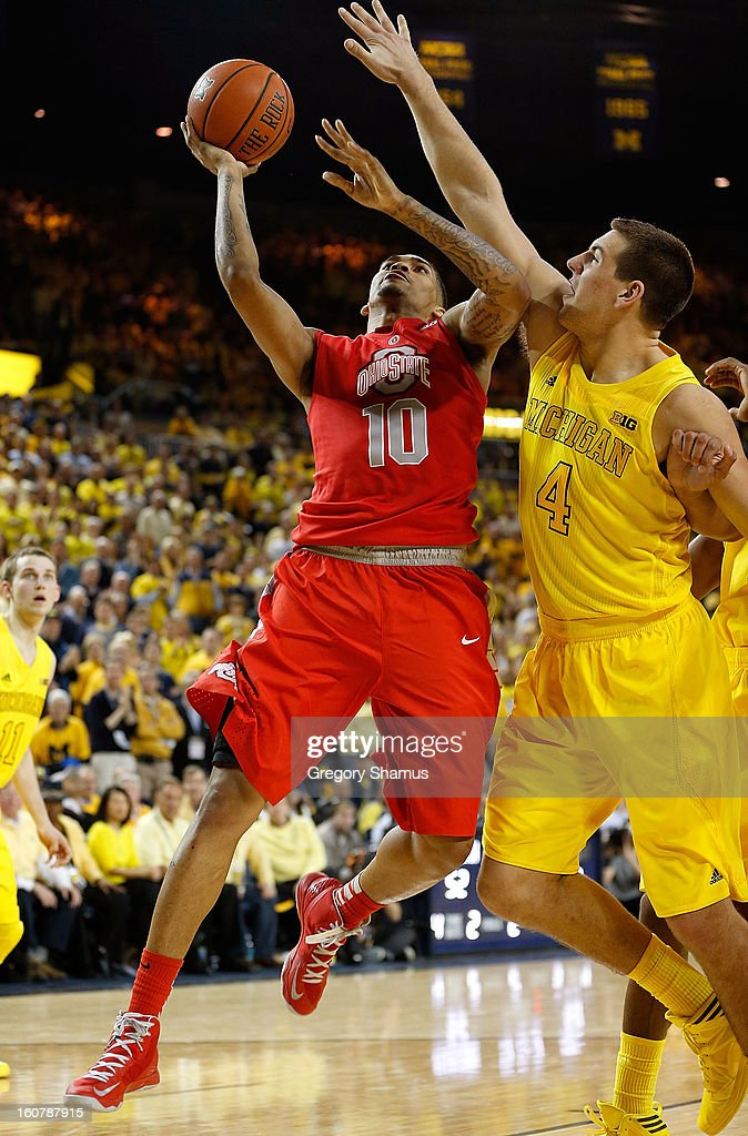 LaQuinton Ross #10 of the Ohio State Buckeyes tries to get a second half shot off around Mitch McGary #4 of the Michigan Wolverines at Crisler Center on February 5, 2013 in Ann Arbor, Michigan. Michigan won the game 76-74 in overtime.