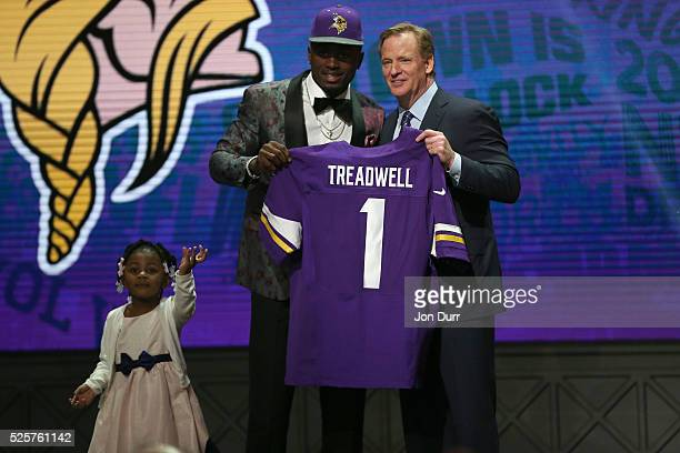 Laquon Treadwell of Ole Miss holds up a jersey with his daughter Madison and NFL Commissioner Roger Goodell after being picked overall by the...