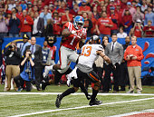 Laquon Treadwell of the Mississippi Rebels catches a touchdown pass against Kevin Peterson and Jordan Sterns of the Oklahoma State Cowboys during the...