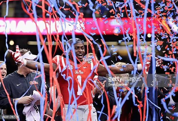 Laquon Treadwell of the Mississippi Rebels celebrates during the trophy ceremony after their 4820 win over the Oklahoma State Cowboys during the...