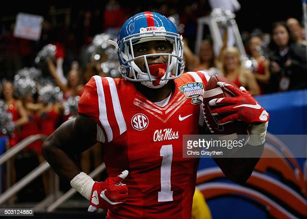 Laquon Treadwell of the Mississippi Rebels celebrates his touchdown against the Oklahoma State Cowboys during the second quarter of the Allstate...