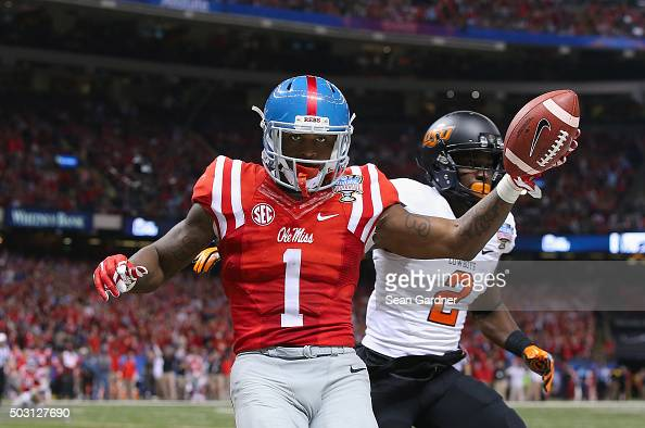 Laquon Treadwell of the Mississippi Rebels celebrates scoring a 14yard touchdown against the Oklahoma State Cowboys during the fourth quarter of the...