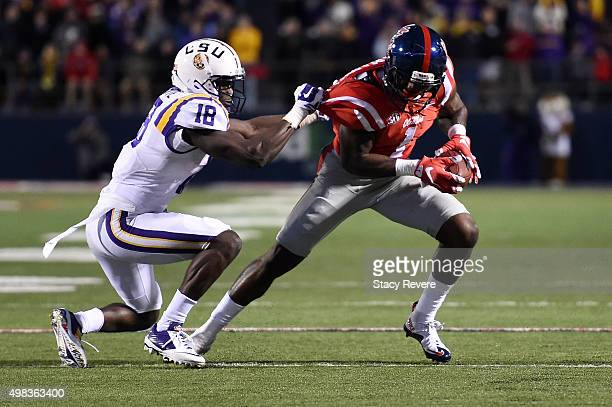 Laquon Treadwell of the Mississippi Rebels is pursued by Tre'Davious White of the LSU Tigers during a game at VaughtHemingway Stadium on November 21...