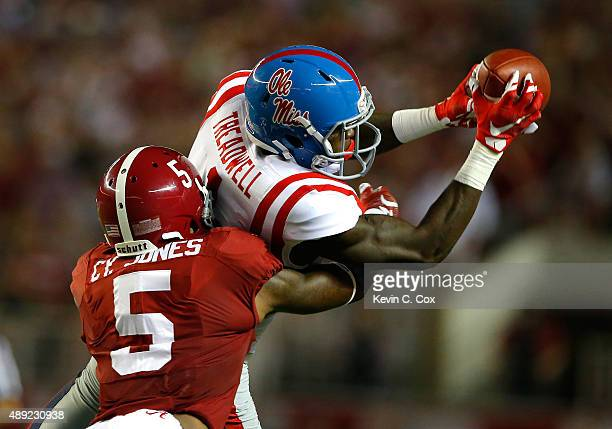 Laquon Treadwell of the Mississippi Rebels pulls in this reception against Cyrus Jones of the Alabama Crimson Tide at BryantDenny Stadium on...
