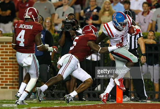 Laquon Treadwell of the Mississippi Rebels pulls in this touchdown receptiong against Cyrus Jones and Eddie Jackson of the Alabama Crimson Tide at...