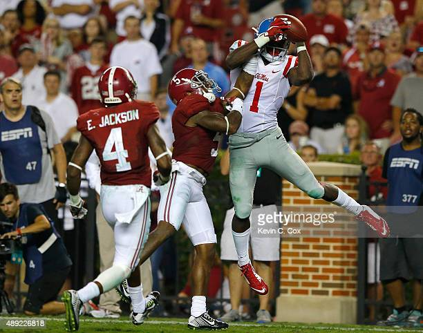 Laquon Treadwell of the Mississippi Rebels pulls in this touchdown reception against Cyrus Jones and Eddie Jackson of the Alabama Crimson Tide at...