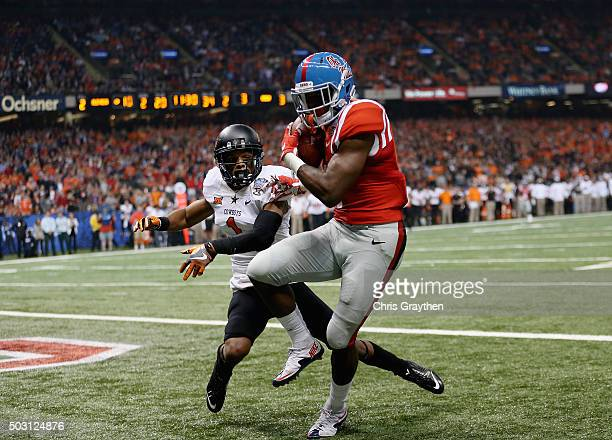 Laquon Treadwell of the Mississippi Rebels scores a touchdown against Kevin Peterson of the Oklahoma State Cowboys during the second quarter of the...