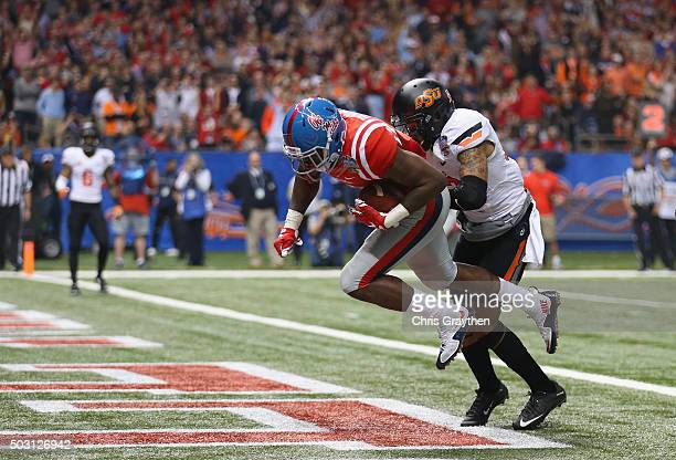 Laquon Treadwell of the Mississippi Rebels scores a touchdown against Jordan Sterns of the Oklahoma State Cowboys during the second quarter of the...