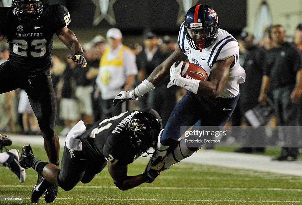 Laquon Treadwell #1 (R) of the Ole Miss Rebels is tackled by Javon Marshall #31 of the Vanderbilt Commodores at Vanderbilt Stadium on August 29, 2013 in Nashville, Tennessee.