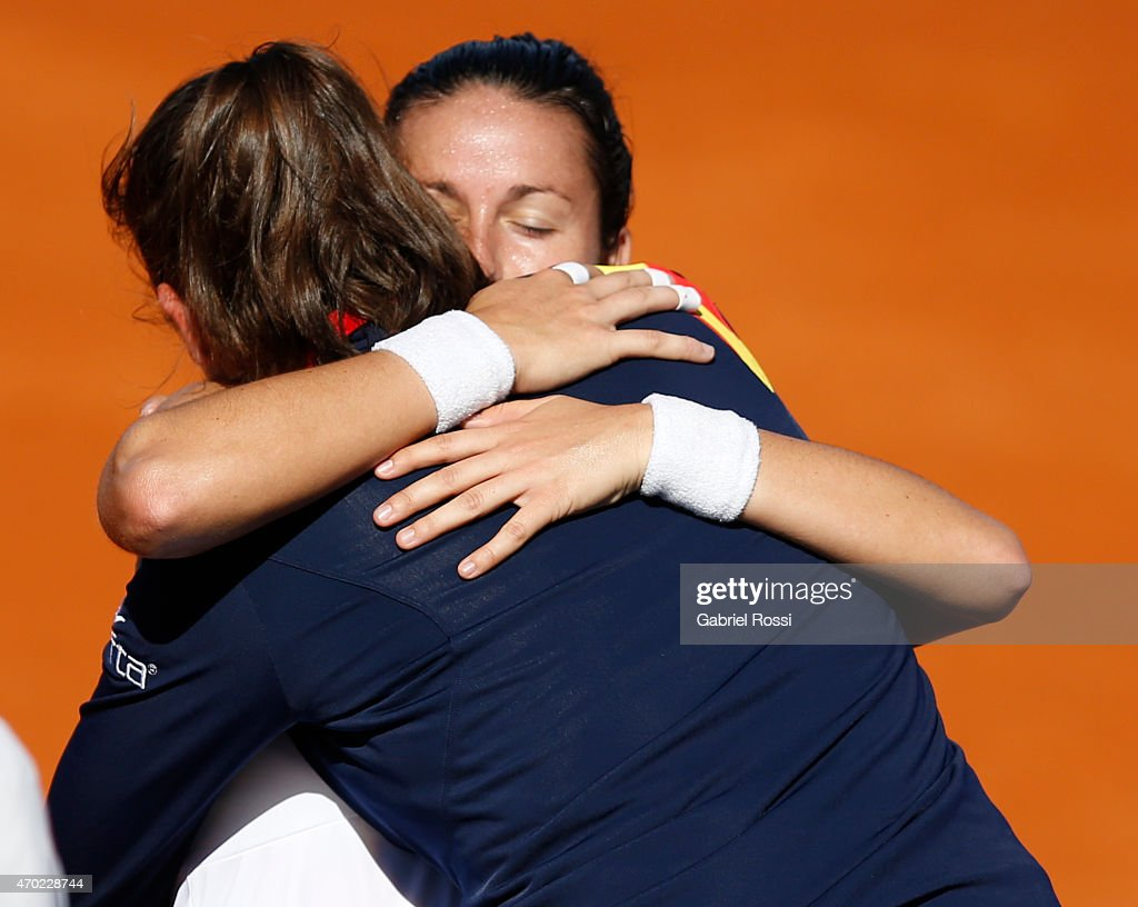 Lara Arruabarrena of Spain celebrates with Sara Sorribes Tormo of Spain after finishing a round 2 match between Maria Irigoyen of Argentina and Lara Arruabarrena of Spain as part of World Group II Playoffs of Fed Cup 2015 between Argentina and Spain at Tecnopolis on April 18, 2015 in Villa Martelli, Buenos Aires, Argentina. The playoff will decide who gets to maintain their position in the group.