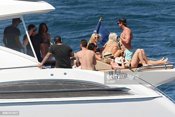 Lara Bingle and new boyfriend Sam Worthington enjoy a day out on a boat on Sydney Harbour with friends on October 10 2013 in Sydney Australia