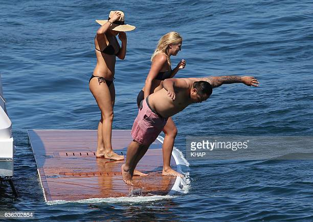 Lara Bingle enjoys a day out on a boat on Sydney Harbour with friends on October 10 2013 in Sydney Australia
