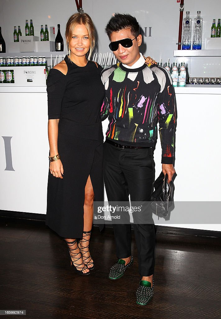 <a gi-track='captionPersonalityLinkClicked' href=/galleries/search?phrase=Lara+Bingle&family=editorial&specificpeople=553554 ng-click='$event.stopPropagation()'>Lara Bingle</a> poses alongside fashion blogger Bryanboy during Mercedes-Benz Fashion Week Australia Spring/Summer 2013/14 at Carriageworks on April 8, 2013 in Sydney, Australia.