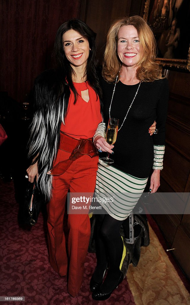 Lara Bohinc (L) and Erin Morris attend the Julien Macdonald show during London Fashion Week Fall/Winter 2013/14 at Goldsmiths' Hall on February 16, 2013 in London, England.