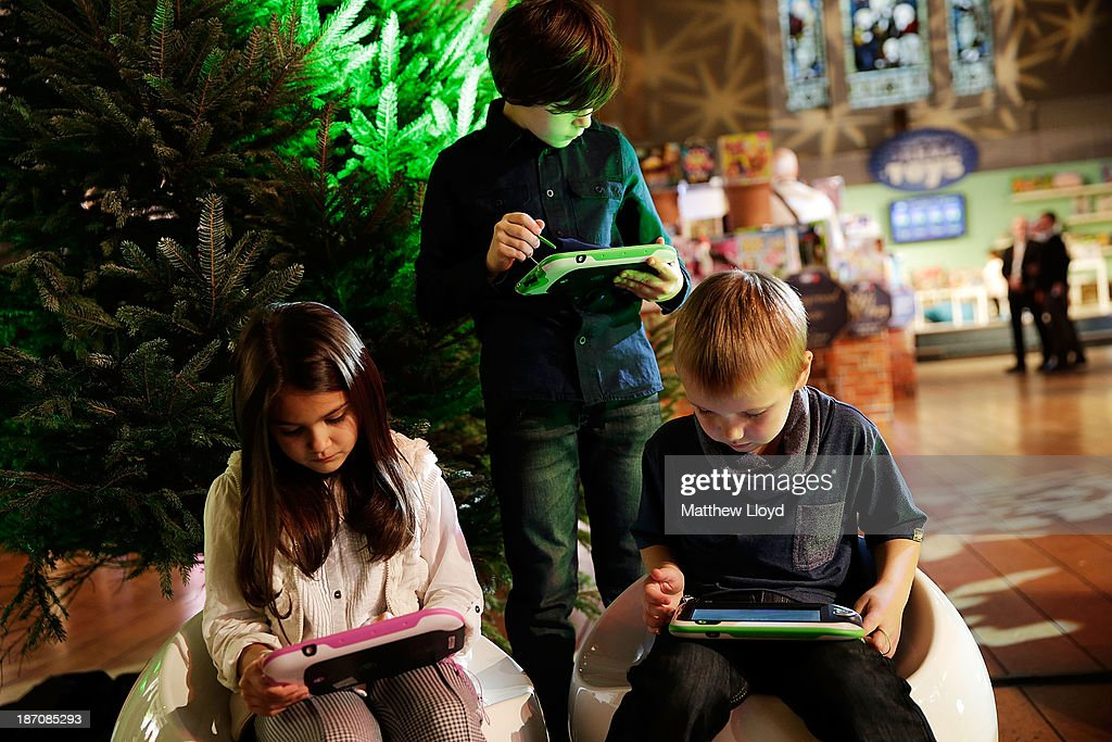 Lara Decara (9), Kallum Cokin-Reffell (9) and Markus Pukite (5) play on LeapPad Ultra at a media event at St Mary's Church in Marylebone on November 6, 2013 in London, England. The Toy Retailers Association's Dream Toys chart, is an independent list of the predicted Christmas top 12 best-selling gifts for children.