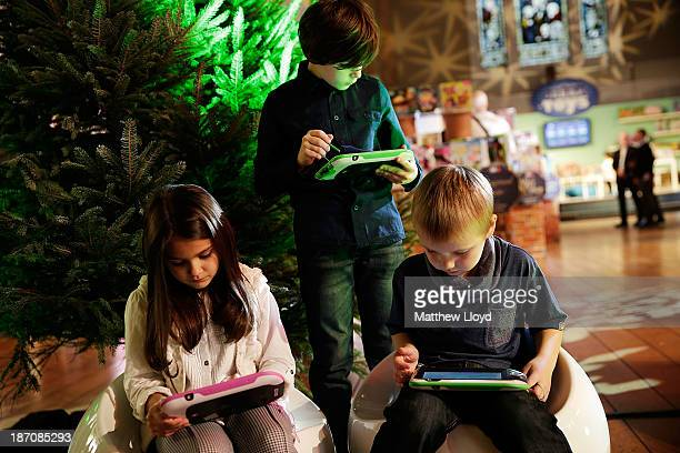Lara Decara Kallum CokinReffell and Markus Pukite play on LeapPad Ultra at a media event at St Mary's Church in Marylebone on November 6 2013 in...