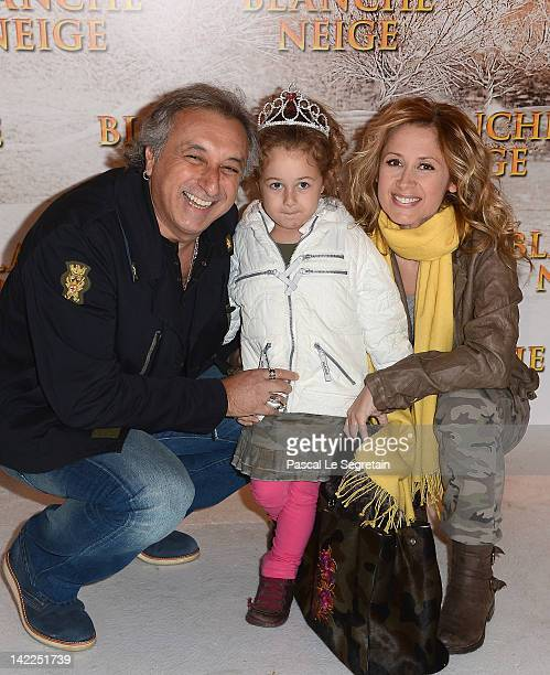 Lara Fabian and Gérard Pullicino pose with their daughter as they attend the 'Blanche Neige' Paris Premiere at Gaumont Capucines on April 1 2012 in...