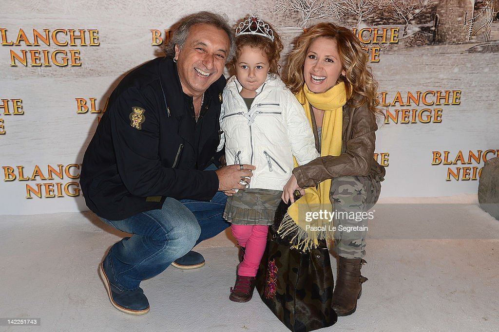 <a gi-track='captionPersonalityLinkClicked' href=/galleries/search?phrase=Lara+Fabian&family=editorial&specificpeople=228901 ng-click='$event.stopPropagation()'>Lara Fabian</a> (R) and Gérard Pullicino (L) pose with their daughter as they attend the 'Blanche Neige' Paris Premiere at Gaumont Capucines on April 1, 2012 in Paris, France.