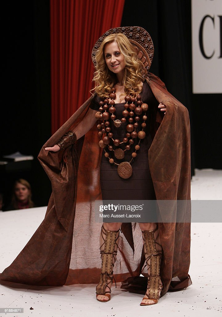 <a gi-track='captionPersonalityLinkClicked' href=/galleries/search?phrase=Lara+Fabian&family=editorial&specificpeople=228901 ng-click='$event.stopPropagation()'>Lara Fabian</a> displays a chocolate decorated dress during the Chocolate dress fashion show celebrating Salon Du Chocolat 15th Anniversary - Opening Night at the Porte Versailles on October 13, 2009 in Paris, France.
