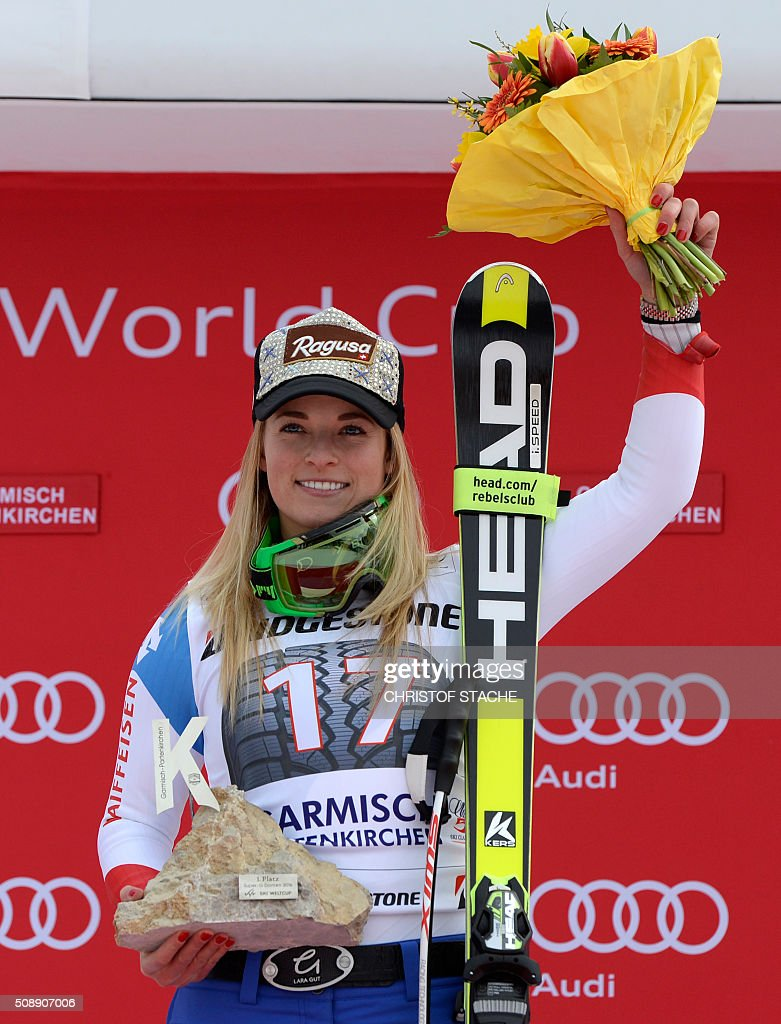 Lara Gut from Switzerland poses during the winner ceremony of the Ladies Super G competition race at the FIS Alpine Skiing World Cup in Garmisch-Partenkirchen, southern Germany, on February 7, 2016. Lara Gut from Switzerland won the competition, Viktoria Rebensburg from Germany placed second and Lindsey Vonn from USA placed third. / AFP / Christof STACHE