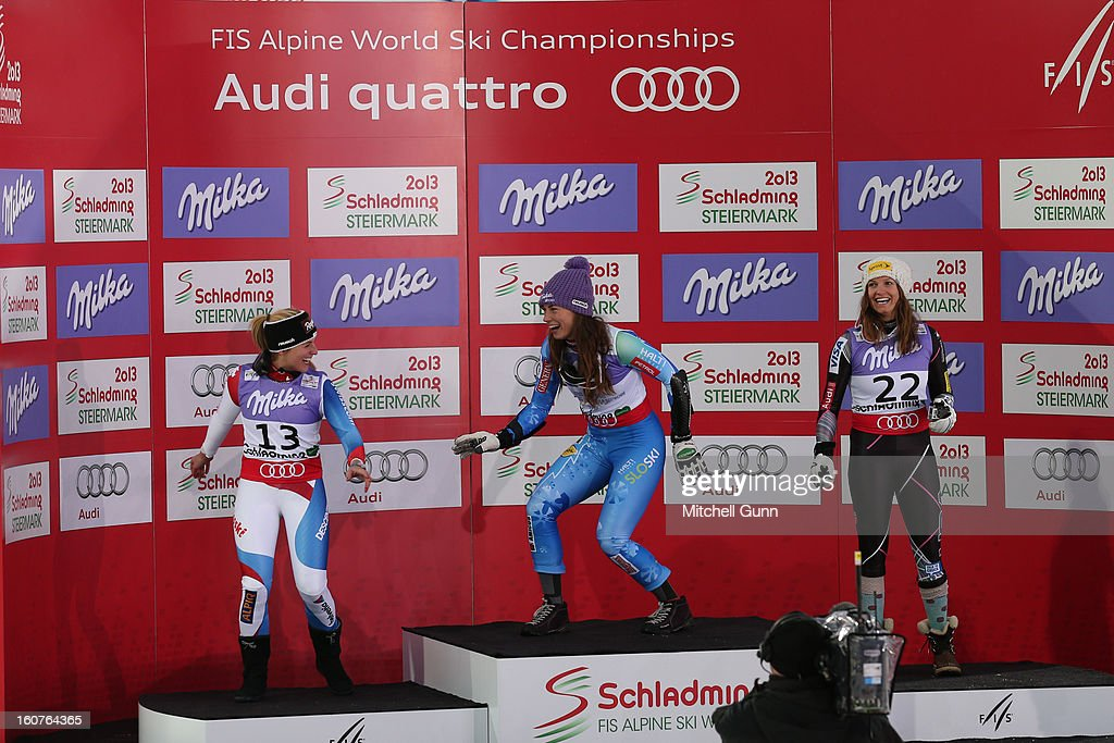 Lara Gut of Switzerland (L) 2nd placed racer Tina Maze of Slovenia (C) race winner and Julia Mancuso of USA (R) 3rd placed racer on the podium for the Alpine FIS Ski World Championships super giant slalom (SuperG) race on February 05, 2013 in Schladming, Austria,