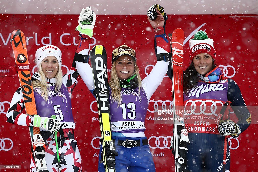 Lara Gut (C) of Switzerland celebrates on the podium after winning the giant slalom along with Eva-Maria Brem (L) of Austria in second place and Federica Brigone (R) of Italy in third place during the Audi FIS Women's Alpine Ski World Cup at the Nature Valley Aspen Winternational on November 27, 2015 in Aspen, Colorado.