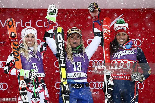 Lara Gut of Switzerland celebrates on the podium after winning the giant slalom along with EvaMaria Brem of Austria in second place and Federica...