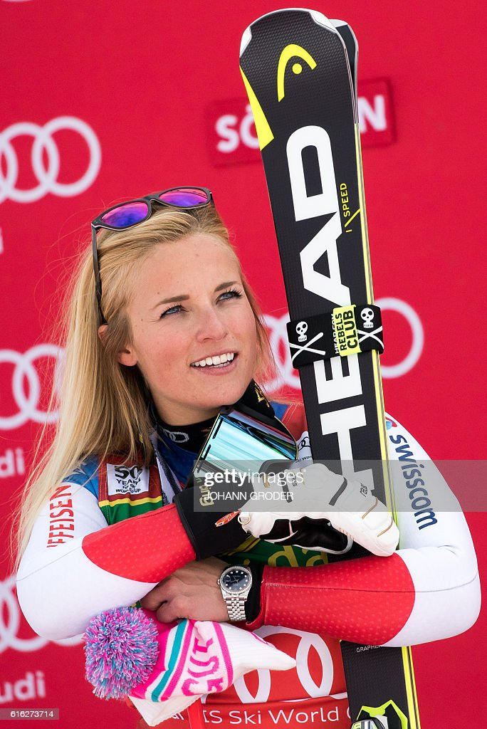 Lara Gut of Switzerland celebrates on the podium after winning the ladies' giant slalom of the FIS Alpine ski world cup in Soelden, Austria on October 22, 2016 / AFP / APA / Johann GRODER / Austria OUT
