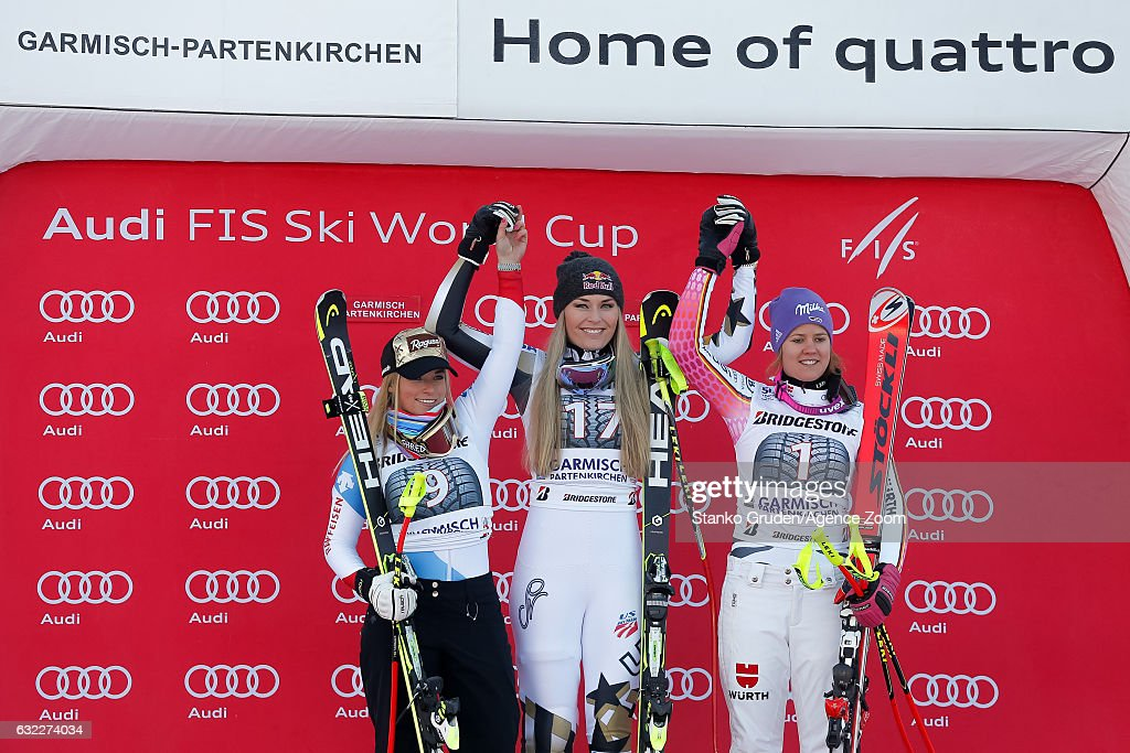 Lara Gut of Switzerland takes 2nd place, Lindsey Vonn of USA takes 1st place, Viktoria Rebensburg of Germany takes 3rd place during the Audi FIS Alpine Ski World Cup Women's Downhill on January 21, 2017 in Garmisch-Partenkirchen, Germany