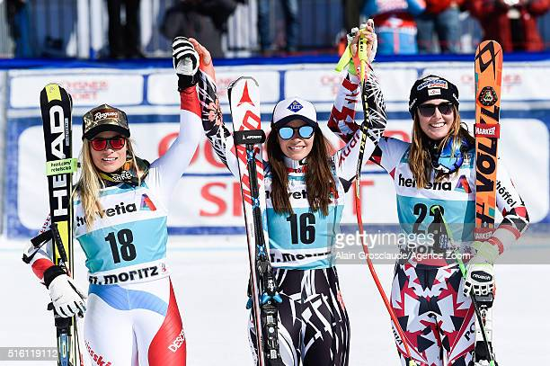 Lara Gut of Switzerland takes 2nd place Tina Weirather of Liechtenstein takes 1st place and Cornelia Huetter of Austria takes 3rd place during the...